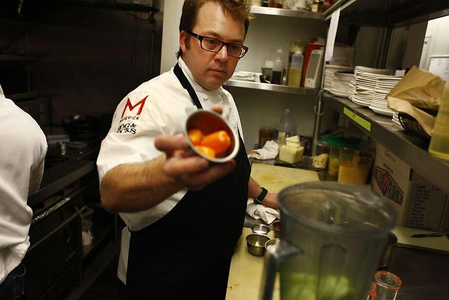 Scott Youkilis makes hot sauce in the kitchen of one of his San Francisco restaurants, Hog & Rocks. Photo: Lea Suzuki, The Chronicle