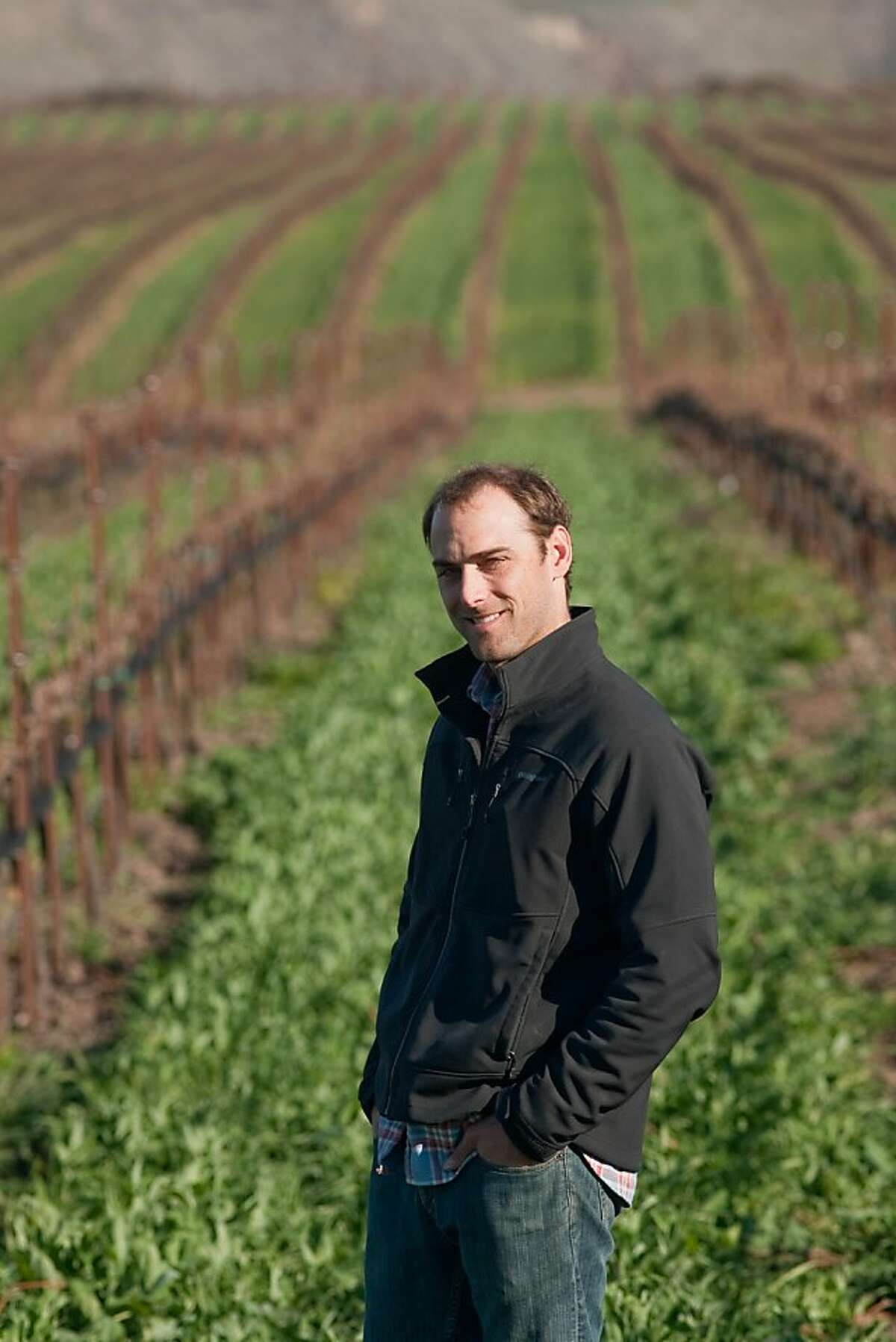 Justin Willett of Tyler Winery at the La Encantada vineyard on Santa Rosa Road off Hwy. 246 between Buellton and Lompoc. The vineyards in the Sta. Rita Hills is known for its chardonnay and pinot noir. (photo by Joe Gosen / Special to the Chronicle)