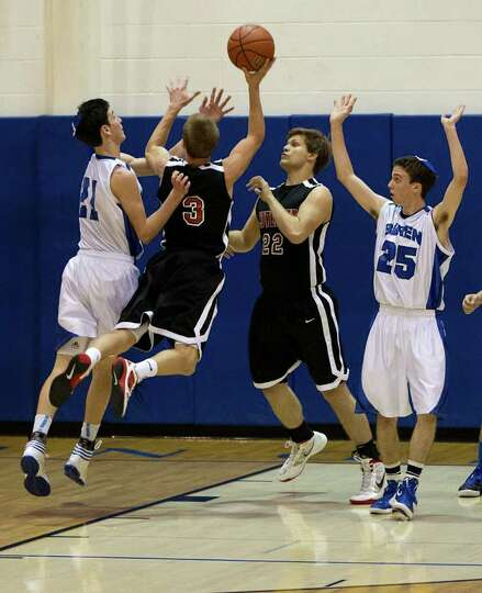 Beren Academy forward Zach Yoshor (21) defends against Dallas Covenant forward Collin Teaster (3) du