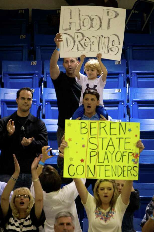 Beren Academy supporters cheat on their team against Dallas Covenant during a TAPPS 2A state semifinal basketball game at Nolan Catholic High School on Friday, March 2, 2012, in Fort Worth.  Beren originally forfeited the game because it interfered with observance of the Jewish Sabbath. After a lawsuit, the time and location of the game was changed. Photo: Smiley N. Pool, Houston Chronicle / © 2012  Houston Chronicle