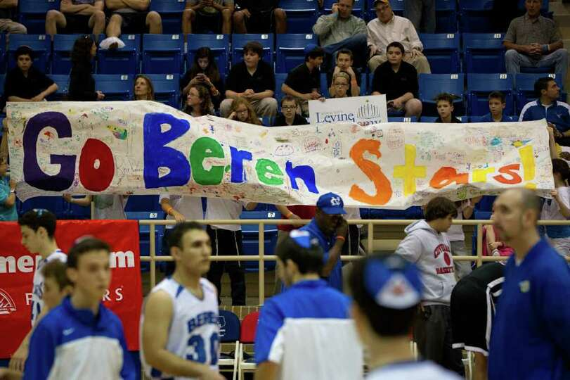Beren Academy supporters hold a banner during warm ups before their team faced Dallas Covenant in a