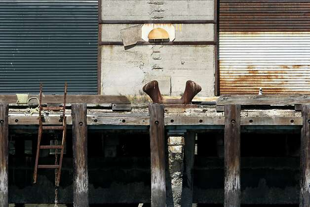 Piers 30-32 have been in need of a renovation. The America's Cup organizers would have been the ones to make a renovation of the dilapidated piers happen. Photo: Sean Culligan, The Chronicle