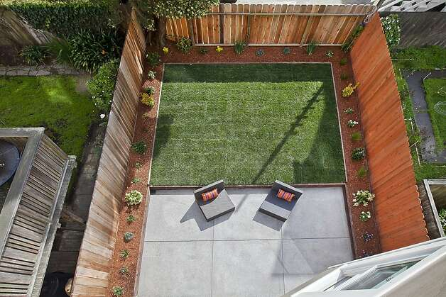 Symmetry, anyone? The backyard patio provides a lesson in how to achieve visual balance. Photo: OpenHomesPhotography.com