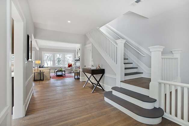 A wide hallway leads to a staircase. Photo: OpenHomesPhotography.com