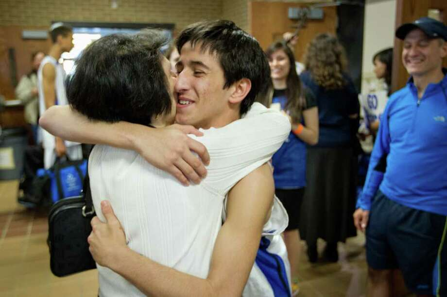 Beren Academy guard Albert Katz hugs his grandmother Joan Katz following the Start victory over Dallas Covenant in a TAPPS 2A state semifinal basketball game at Nolan Catholic High School on Friday, March 2, 2012, in Fort Worth.  Beren originally forfeited the game because it interfered with observance of the Jewish Sabbath. After a lawsuit, the time and location of the game was changed. Beren won the game 58-46 to advance to the championship. Photo: Smiley N. Pool, Houston Chronicle / © 2012  Houston Chronicle