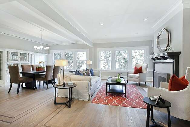 Inside, an open-concept floor plan creates a spacious living arrangement. Photo: OpenHomesPhotography.com