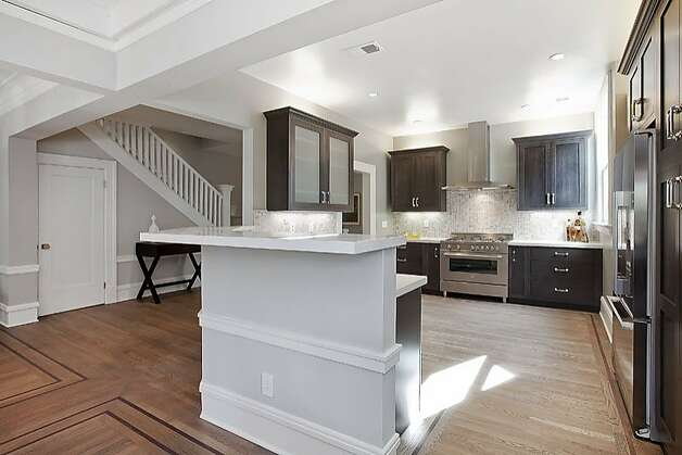 High-end appliances and hardwood flooring can be found in the large kitchen. High-end appliances and hardwood flooring can be found in the large kitchen. Photo: OpenHomesPhotography.com