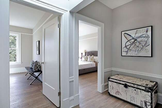 Utilizing a light gray color scheme, the home puts the mind at ease. Photo: OpenHomesPhotography.com