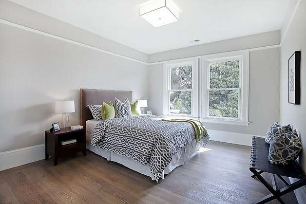 This bedroom is one of six spread across the two-unit home. Photo: OpenHomesPhotography.com