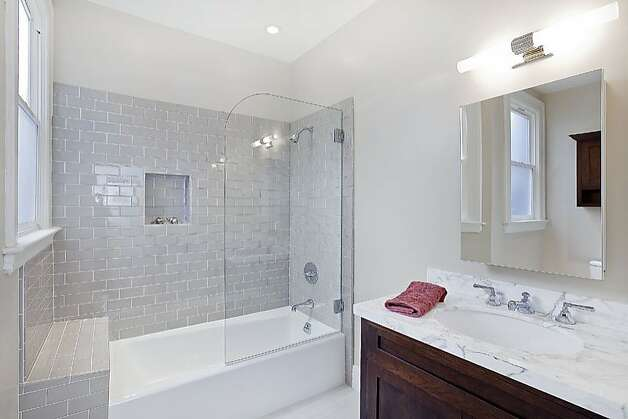 The unit also features four baths. Photo: OpenHomesPhotography.com