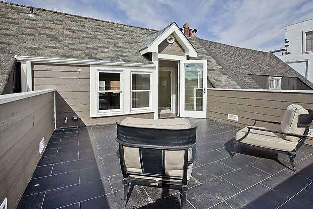 A glass door provides access to the deck. Photo: OpenHomesPhotography.com