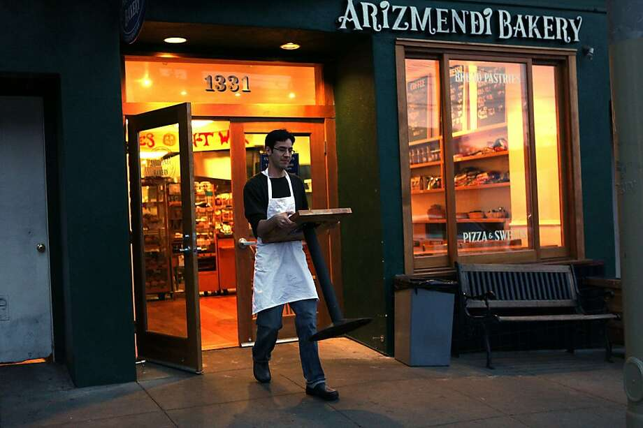 Baker and owner Michael Webb bringing out a table to the parklett in front of Arizmendi bakery in San Francisco Calif., before the bakery opens on Tuesday, February 28, 2012.  Michael Webb has been with Arizmendi bakery for the past 6 years. Photo: Liz Hafalia, The Chronicle