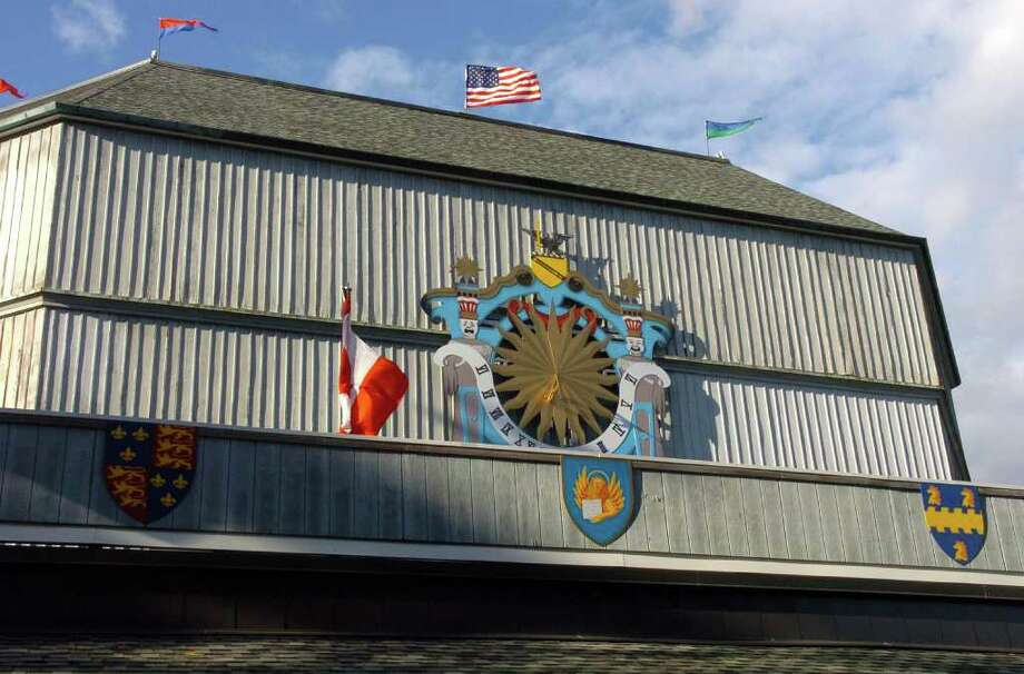 Stratford police are investigating a report that a red and yellow crest depicting a lion has been pried off the façade of the town-owned Shakespeare theater. The crest, one of seven adorning the theater's exterior, was a gift from Timex Group USA in October 2010. Photo: Christian Abraham / Connecticut Post