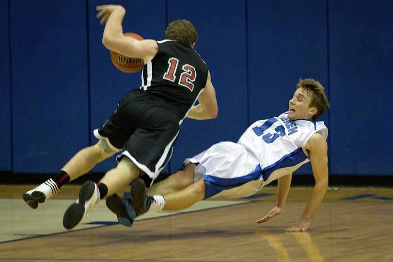 Beren Academy guard Isaac Mirwis (13) is called for a foul in a collision with Dallas Covenant forwa