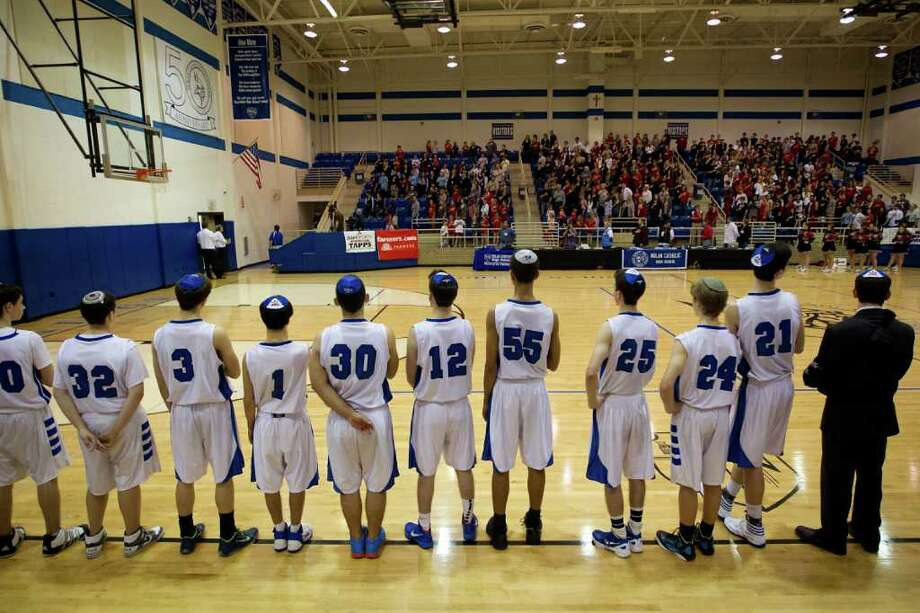 Beren Academy players stand for the national anthem before facing Dallas Covenant during a TAPPS 2A state semifinal basketball game at Nolan Catholic High School on Friday, March 2, 2012, in Fort Worth.  Beren originally forfeited the game because it interfered with observance of the Jewish Sabbath. After a lawsuit, the time and location of the game was changed. Photo: Smiley N. Pool, Houston Chronicle / © 2012  Houston Chronicle