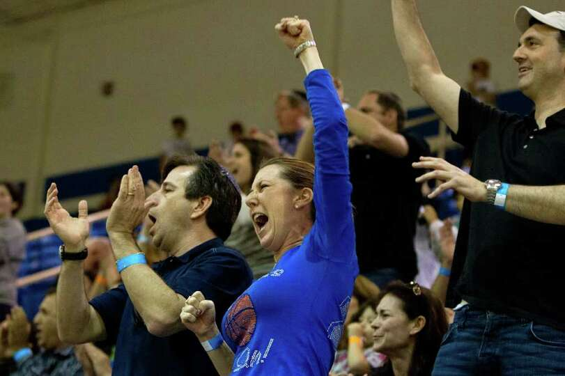 Dorit Guttman, mother of Beren Academy post Ahron Guttman, cheers a Stars basket against Dallas Cove