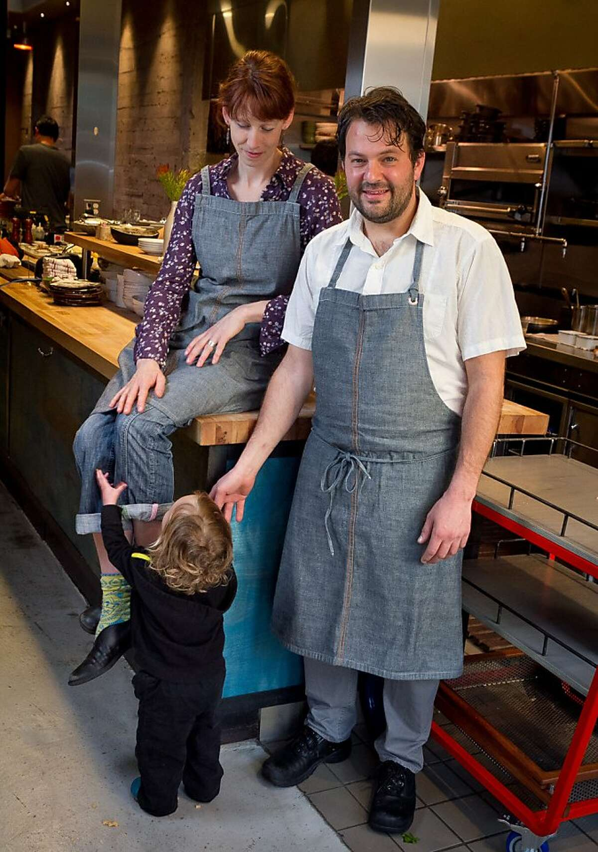 Owner/chef husband and wife team Stuart Brioza and Nicole Krasinski with their son Jasper in the kitchen of State Bird Provisions in San Francisco, Calif., on Saturday, February 25th, 2012.