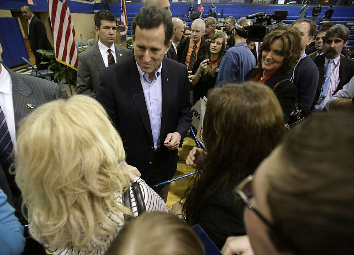 Republican presidential candidate, former Pennsylvania Sen. Rick Santorum greets supporters at Chillicothe High School in Chillicothe, Ohio, Friday, March 2, 2012. (AP Photo/Paul Vernon)