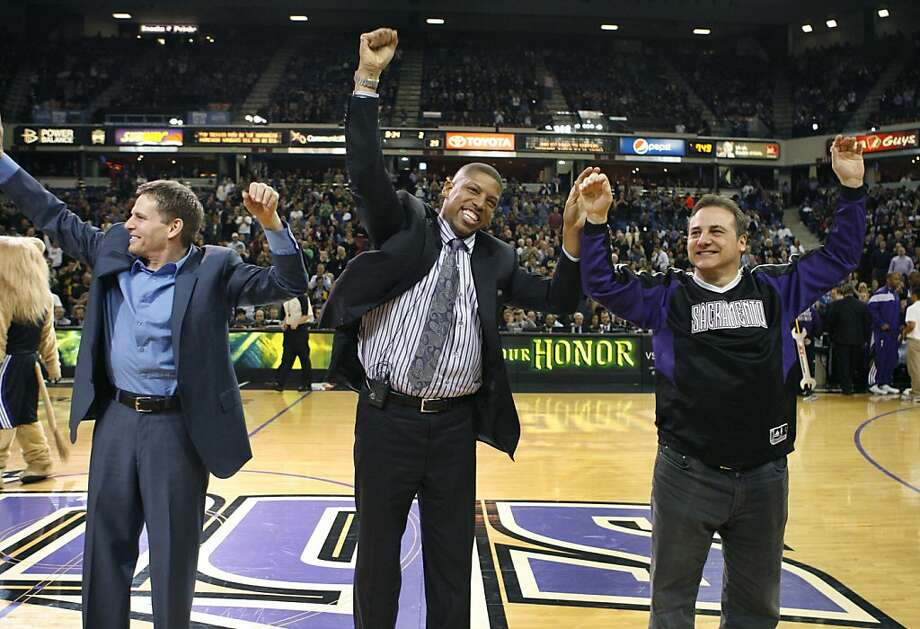 Sacramento Kings owners Joe Maloof, left, and Gavin Maloof, right, celebrate with Sacramento Mayor Kevin Johnson about a tentative agreement to build a new arena and keep the team in Sacramento, at center court during a timeout during the first half of an NBA basketball game between the Kings and the Utah Jazz in Sacramento, Calif., Tuesday, Feb. 28, 2012. (AP Photo/Steve Yeater) Photo: Steve Yeater, Associated Press