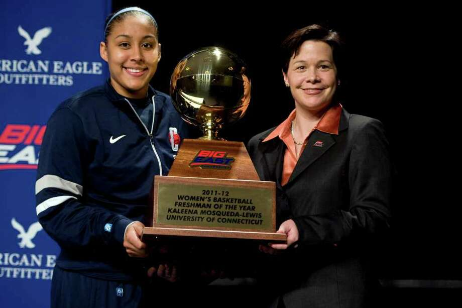 Connecticut's Kaleena Mosqueda-Lewis, left, receives the NCAA college basketball Big East Conference's Freshman of the Year award from associate commissioner Danielle Donehew in Hartford, Conn., Friday, March 2, 2012. (AP Photo/Jessica Hill) Photo: Jessica Hill, Associated Press / AP2012