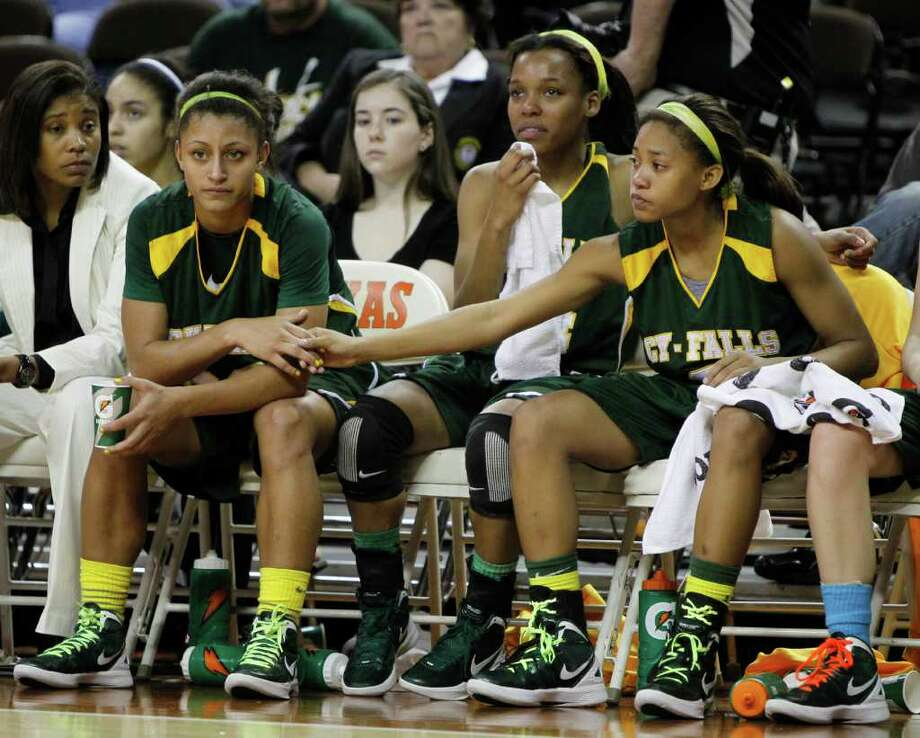 3/2/12  -  Houston Cypress Falls' Loryn Goodwin (32), left, gets a hand from teammate Sadalia Ellis (3), far right, in the last minutes of their loss to Duncanville during the 5A Girls UIL state basketball semifinals in Austin, Texas March 2, 2012. (Erich Schlegel/Special Contributor) Photo: Erich Schlegel, Houston Chronicle / ©2012 Erich Schlegel