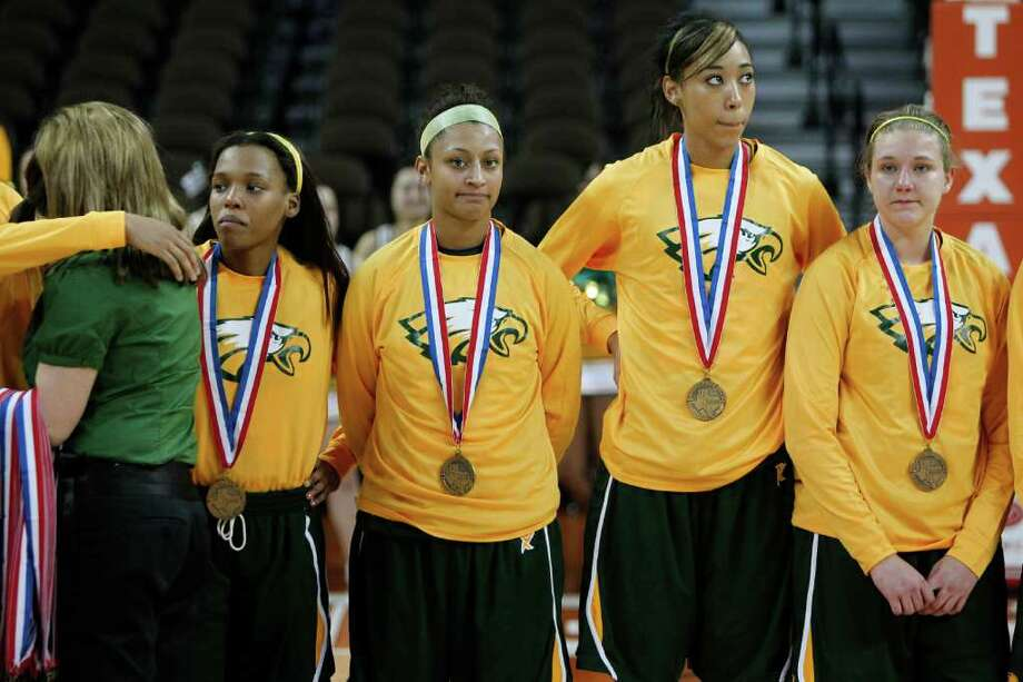 Class 5A state semifinal: Duncanville 64, Cypress Falls 40 - Cypress Falls' Loryn Goodwin (32), second from left, and teammates get their third-place medals after losing to Duncanville. Photo: Erich Schlegel, Houston Chronicle / ©2012 Erich Schlegel