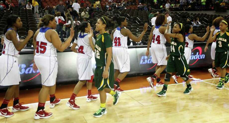 Cypress Falls' Loryn Goodwin (32) and teammates congratulate Duncanville. Photo: Erich Schlegel, Houston Chronicle / ©2012 Erich Schlegel