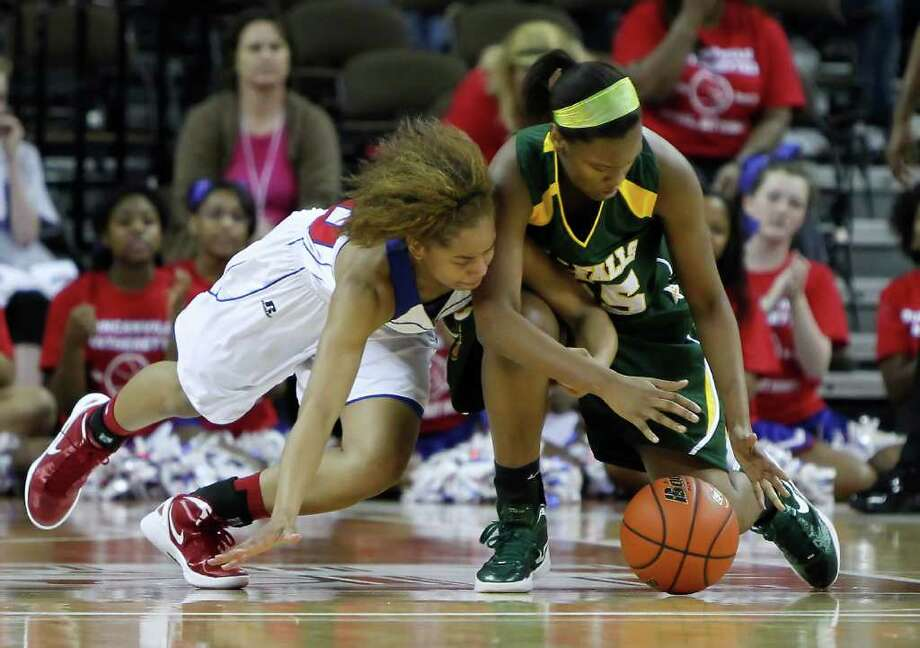 Duncanville's Kiara Perry (00) fights Cypress Falls' Kayla Tarver (25) for a loose ball. Photo: Erich Schlegel, Houston Chronicle / ©2012 Erich Schlegel