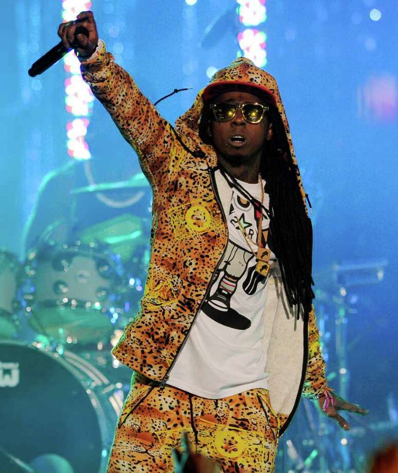 "Lil Wayne performs at the Caesars Entertainment ""Escape To Total Rewards"" concert in Los Angeles, Thursday, March 1, 2012. Simultaneous concert events were held in New York, Chicago, New Orleans and Los Angeles. (AP Photo/Chris Pizzello) Photo: Chris Pizzello / AP"