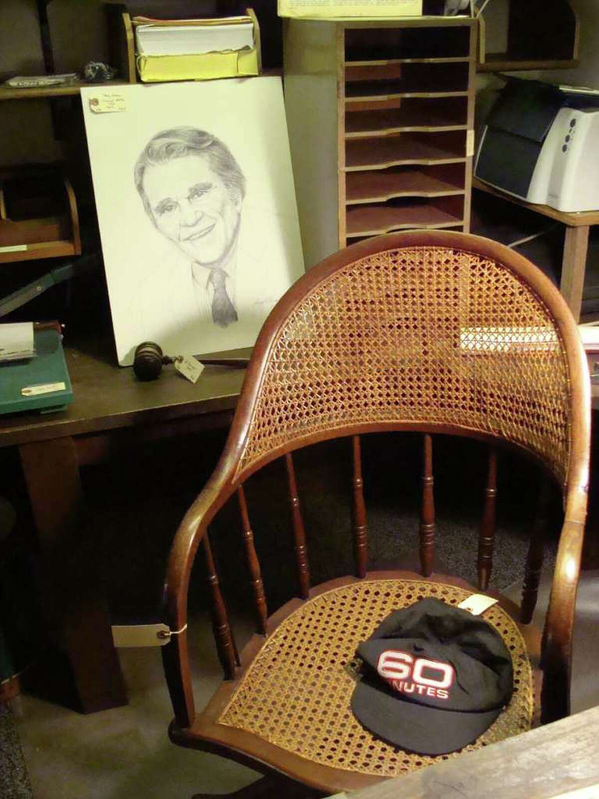 """Andy Rooney's basement office chair in his Rowayton home, his """"60 Mintues"""" cap and a portrait were among the items on sale Friday, the first day of a three-day estate sale."""