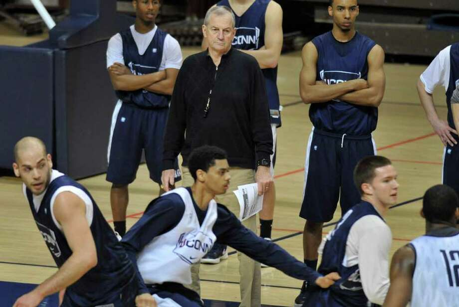 Connecticut head coach Jim Calhoun, center, watches players during his first practice since having successful lower back surgery in Storrs, Conn., Friday, March 2, 2012.  (AP Photo/Jessica Hill) Photo: Jessica Hill, Associated Press / AP2012