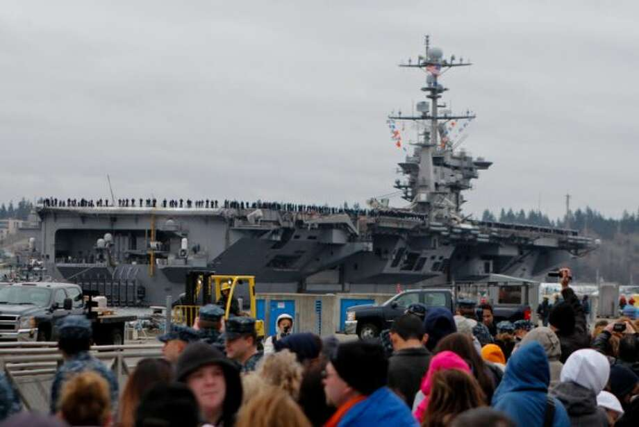 In this file photo, the USS John C. Stennis aircraft carrier returns to Naval Base Kitsap in Bremerton WA. on Friday, March 02, 2012.