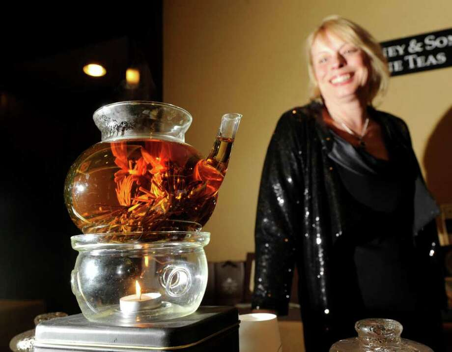 Nancy Dacey of Harney & Sons Tea Company brews a kettle of Jasmine Art tea during the 27th annual Great Chefs event at the Hyatt Regency Greenwich Friday night, March 2, 2012. Photo: Bob Luckey / Greenwich Time