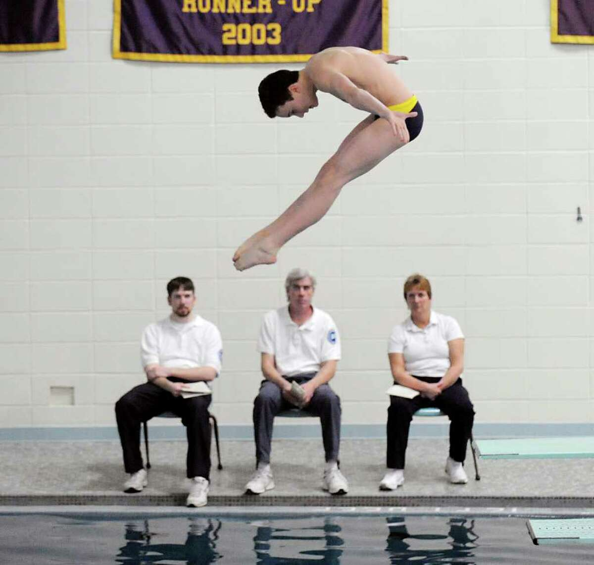 Sean Burston of Westhill/Stamford Co-op competes in the FCIAC diving championships at Westhill High School in Stamford, Friday, Match 2, 2012. Burston won the event.
