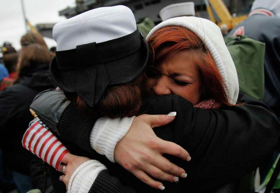 Samantha Squires welcomes her sister Stephanie back from a seven month deployment aboard the USS John C. Stennis, at Naval Base Kitsap, Bremerton WA. Friday, March 2, 2012. Photo: JOE DYER / SEATTLEPI.COM