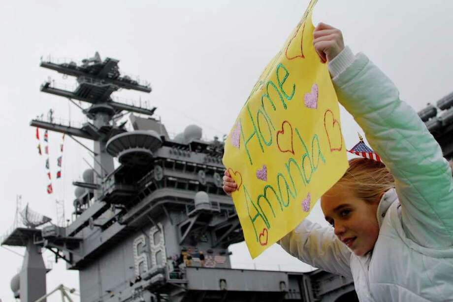 Sydney, 10, Awaits the return of the USS John C. Stennis aircraft carrier at Naval Base Kitsap in Bremerton WA. on Friday, March 02, 2012. The carrier had been deployed for seven months. Photo: JOE DYER / SEATTLEPI.COM