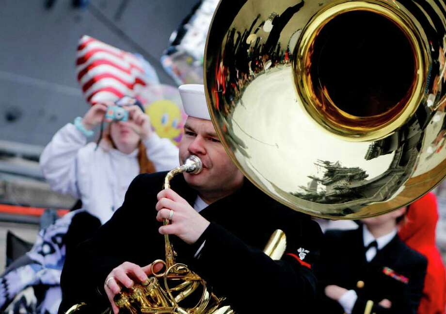 A Navy band member plays as people await the arrival of the USS John C. Stennis aircraft carrier at Naval Base Kitsap in Bremerton WA. on Friday, March 02, 2012. The carrier had been deployed for seven months. Photo: JOE DYER / SEATTLEPI.COM