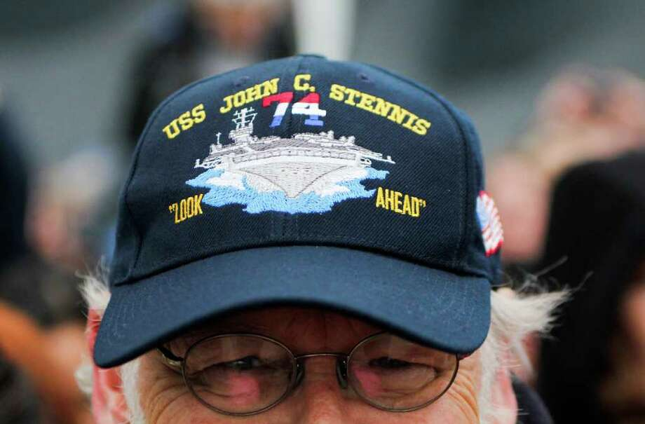 Dave Findley awaits the return of the USS John C. Stennis aircraft carrier at Naval Base Kitsap in Bremerton WA. on Friday, March 02, 2012. The carrier had been deployed for seven months. Photo: JOE DYER / SEATTLEPI.COM