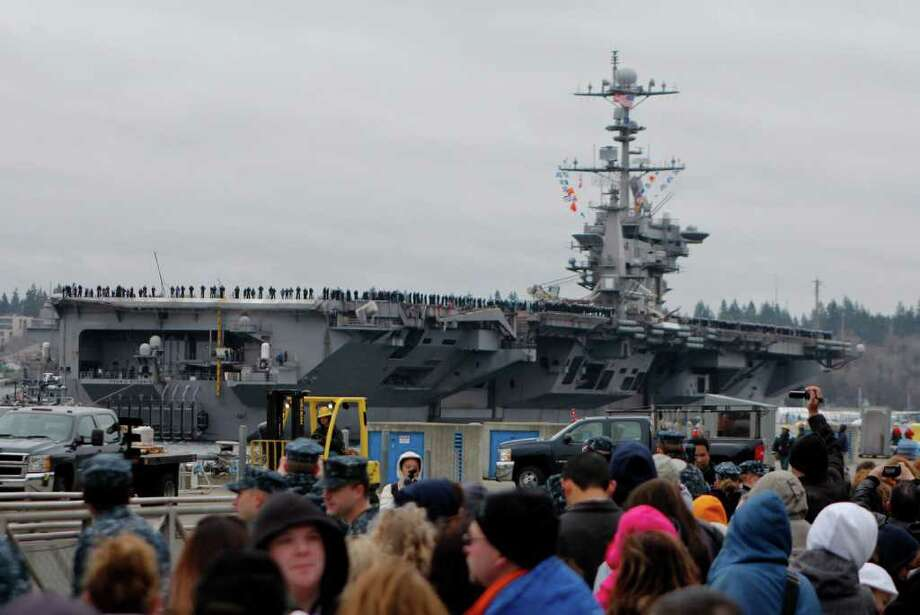 The USS John C. Stennis aircraft carrier returns to Naval Base Kitsap in Bremerton WA. on Friday, March 02, 2012. The carrier had been deployed for seven months. Photo: JOE DYER / SEATTLEPI.COM