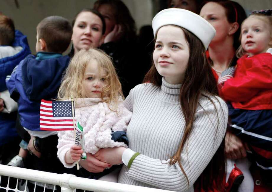 Victoria Olds and her little sister Lileeana await the return of their father from the  USS John C. Stennis aircraft carrier at Naval Base Kitsap in Bremerton WA. on Friday, March 02, 2012. The carrier had been deployed for seven months. Photo: JOE DYER / SEATTLEPI.COM