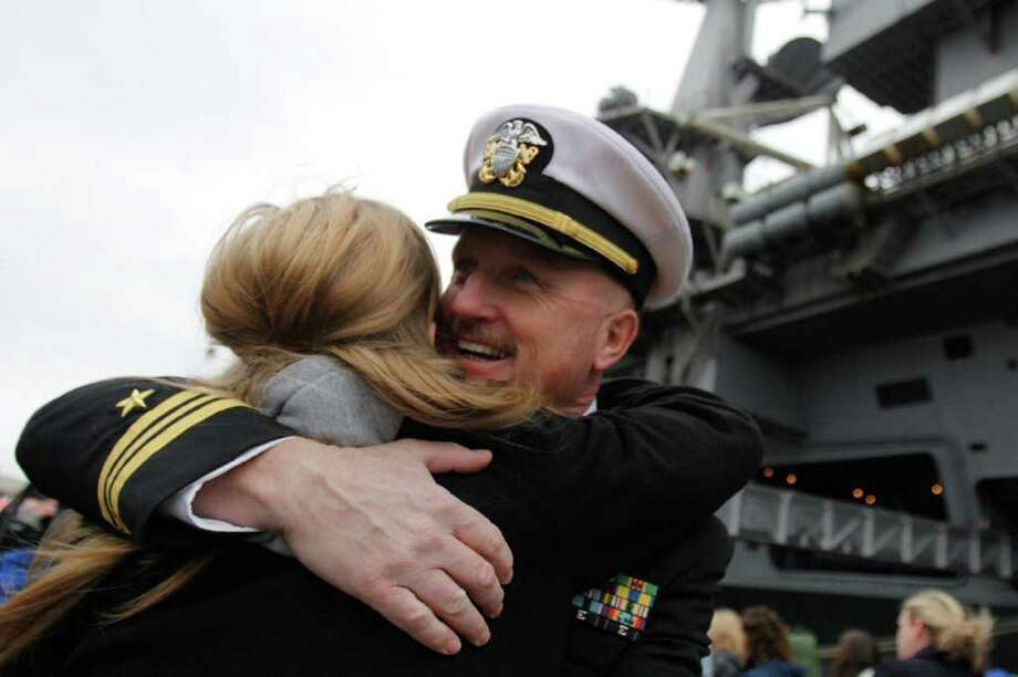 Kevin Dowd hugs daughter after returning from a seven month deployment aboard the USS John C. Stennis, Naval Base Kitsap, Bremerton WA. Friday, March 2, 2012. Photo: JOE DYER / SEATTLEPI.COM