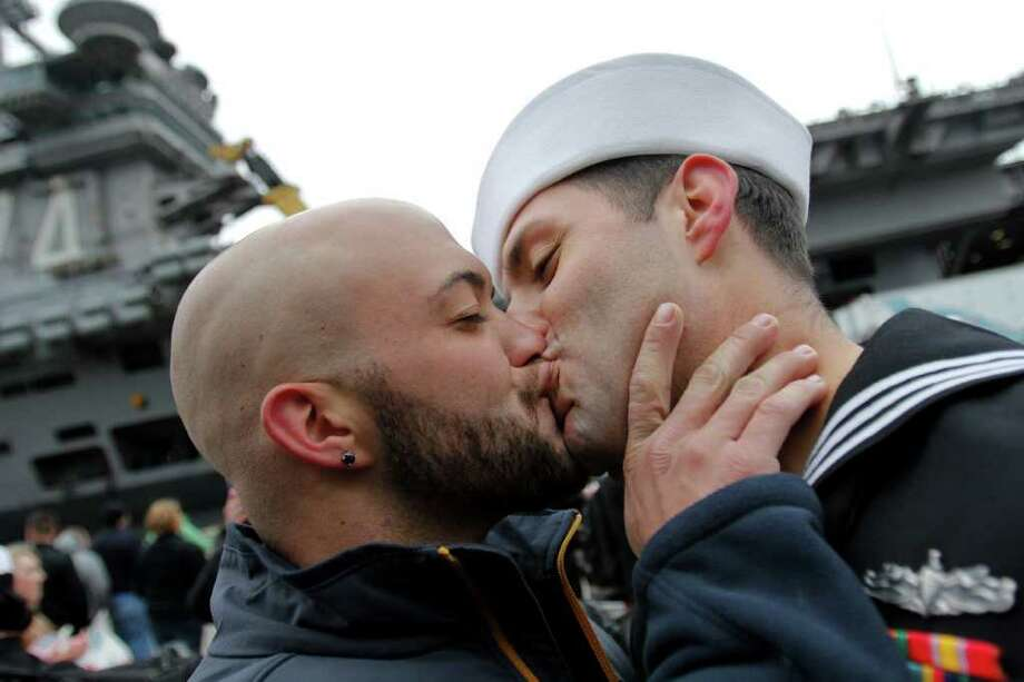 Sean Sutton greets his boyfriend of 2 years Jonathan Jewell rank E5 with a kiss after he returned from his seven month deployment aboard John C. Stennis aircraft carrier in Bremerton WA. On Friday, March 02, 2012. Photo: JOE DYER / SEATTLEPI.COM