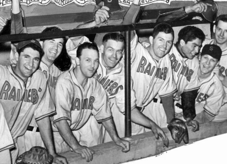 When was this photo taken of the Seattle Rainiers celebrating their climb to second place in Pacific Coast League standings? (seattlepi.com file)