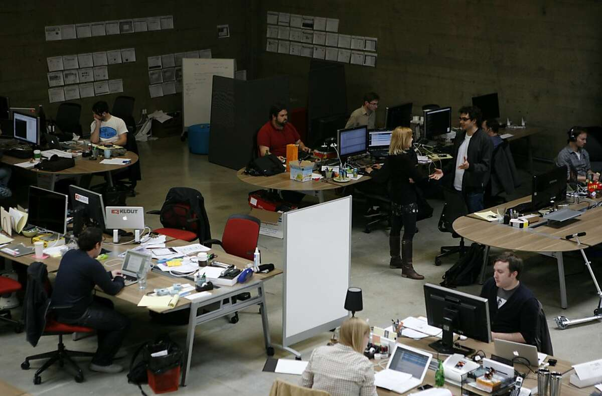 Joe Fernandez (bottom left) CEO and co-founder of Klout, a company that rates social media influence, works at his desk in the Klout office at 77 Stillman street, San Francisco, on Wednesday March 9, 2011.