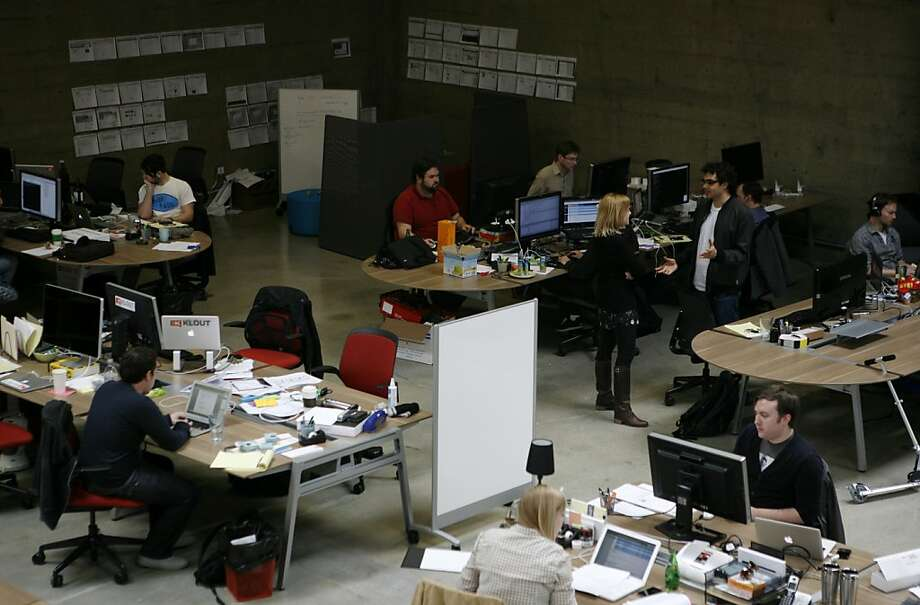 Joe Fernandez (bottom left) CEO and co-founder of Klout, a company that rates social media influence, works at his desk in San Francisco. Photo: Anna Vignet, The Chronicle