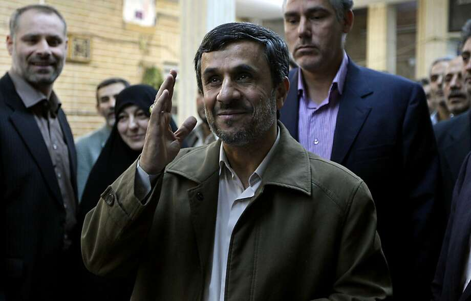 Iranian President Mahmoud Ahmadinejad gestures after voting at a polling station in Tehran on March 2, 2012. Iran voted for a new parliament in the first nationwide elections since a bitterly contested 2009 poll that returned Ahmadinejad to power, posing a new test of his support among conservatives. Photo: Atta Kenare, AFP/Getty Images