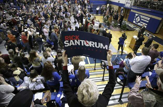 A supporter holds up a campaign sign during a rally for Republican presidential candidate, former Pennsylvania Sen. Rick Santorum at Chillicothe High School in Chillicothe, Ohio, Friday, March 2, 2012. Photo: Paul Vernon, Associated Press
