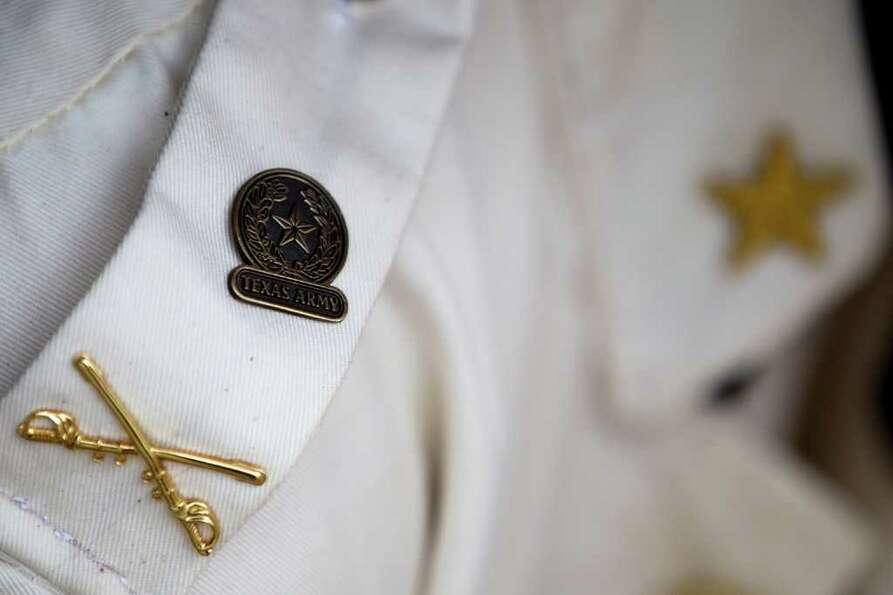 Texas Army logos adorn the coat of Tony Emmitte during a commemoration ceremony for Texas Independen