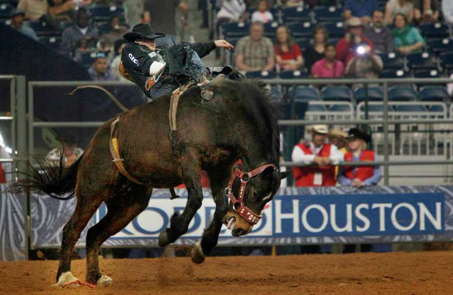 Jessy Davis competes in Bareback RIdding during the Rodeo Houston BP Super Series II at Reliant Stad
