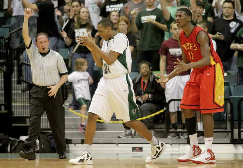 3/2/2012: Melvin Swift #12 of Yates is called for a fowl against Dante Willis #21 of Kingwood Park i